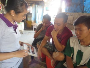 Gung Ayu explaining to the young men the importance of sexual health